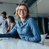 Female designer sitting in board room